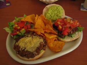 Mexican-Style UMAMI BURGERS with mango salsa and guacamole.